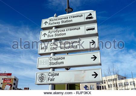 Direction signs in Cyrillic and Roman script in the city of Novi Sad, Vojvodina, Serbia. - Stock Image
