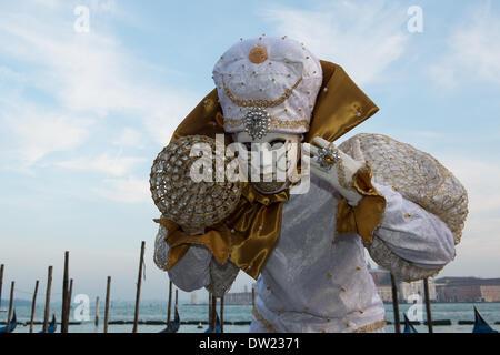 Venice, Italy. 25th Feb, 2014. Giorgio Cauchi a native Italian poses with a diamante studded ball at the waters edge. Venice Carnivale Credit:  MeonStock/Alamy Live News - Stock Image