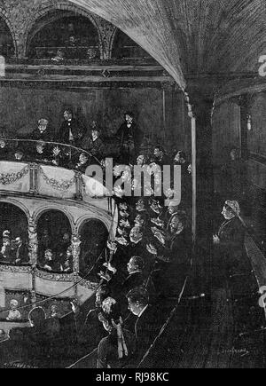 The 'claque' - a group of hired applauders - clapping vociferously in the gallery of a French theatre in support of an actor/actress who needs the publicity - Stock Image
