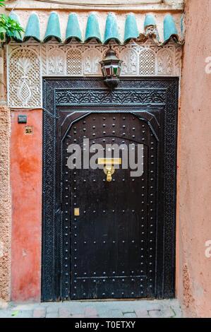 Black door in the Medina of Marrakech, Morocco - Stock Image