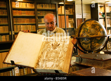 librarian of the famous historic library in Jesi,Le Marche,Italy,shows the family tree of the Pianetti family of - Stock Image