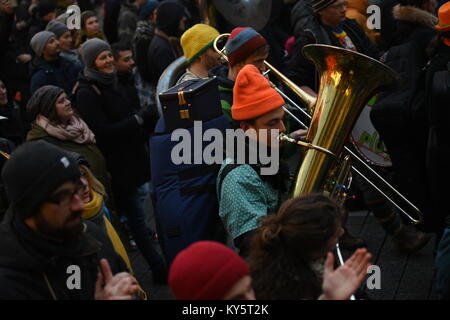Vienna, Austria. 13th Jan, 2018. musician plays while marching  during an anti-government demonstration. Credit: - Stock Image