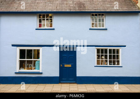 Front of attractive old two tone blue painted house / cottage, now part of Fords department store shop, Oakham Rutland, England, UK - Stock Image