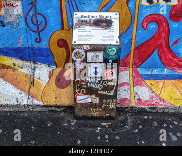 Berlin,Friedrichshain. Berlin Wall East Side Gallery Information sign. Memorial wall must not be damaged or defaced - Stock Image