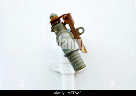 Close up Tap with White Concrete Wall. (Selective Focus) - Stock Image