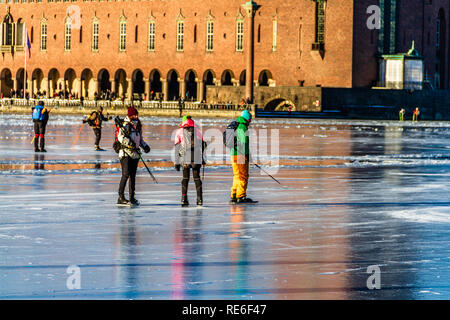 People ice skating on Riddarfjarden, Lake Malaren, in front of the City Hall. Stockholm, Sweden. 20th January, 2019. - Stock Image