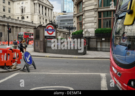 London street with the Underground roundel and roadworks - Stock Image