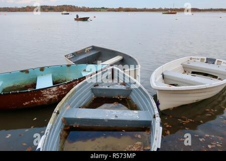 Rowing boats beside the River Deben, Waldringfield, Suffolk, UK. Winter - November 2018. - Stock Image