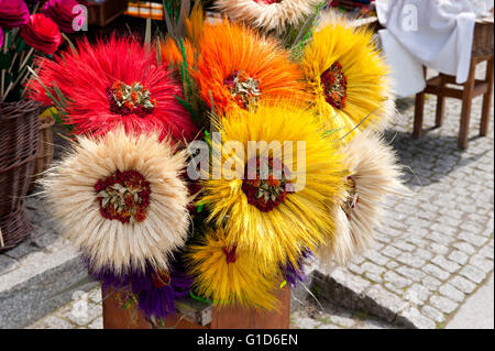 Artificial cereal folk art flowers bunch, souvenirs at the bazaar in Kazimierz Dolny, Poland, Europe, bohemian tourist - Stock Image