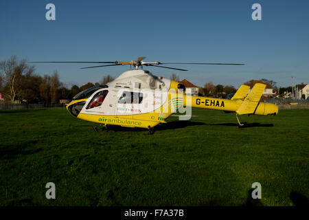 Essex and Herts air ambulance trust helicopter at bathhouse meadow Walton on the Naze - Stock Image