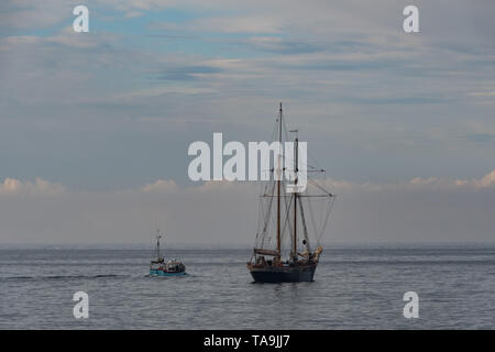 Mousehole, Cornwall, UK. 23rd May 2019. UK Weather. After days of virtually unbroken sunshine there were clouds back in the sky early this morning, with the threat of some showers later on. Credit Simon Maycock / Alamy Live News. - Stock Image
