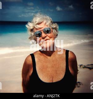 Lovely kind energetic senior citizen wearing black bathing suit - Stock Image
