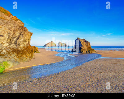 Rocks on Holywell Beach, with a view through  to Carters Rocks, North Cornwall, UK - Stock Image