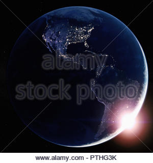 Sun rising over North and South America from space - Stock Image