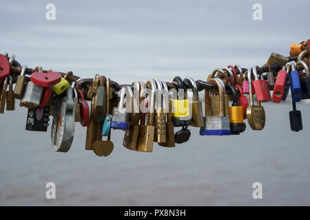 Love locks on a railing overlooking the River Mersey in the Albert Dock Liverpool UK - Stock Image