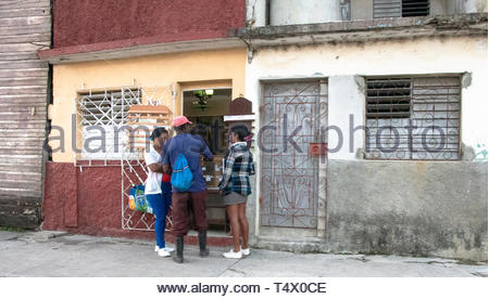 Sagua La Grande, Villa Clara, Cuba, people having breakfast on a private small cafeteria which operates on a private house. - Stock Image