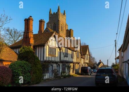 Stoke By Nayland, view of a row of medieval town houses in Church Street with the tower of St Mary The Virgin Church visible above them, Suffolk, UK - Stock Image