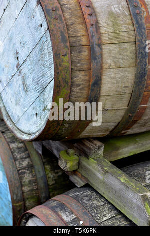 Old, antique wooden barrel freight shipping containers - Stock Image