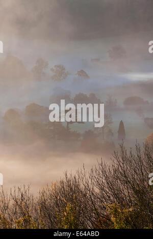 Misty autumn morning, Uley, Gloucestershire, UK - Stock Image