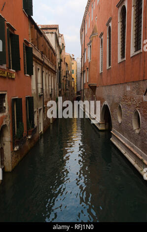 A narrow venetian Canal - Stock Image