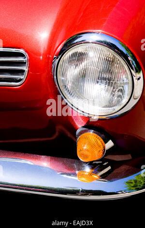 Closeup on headlight of old shiny retro car - Stock Image