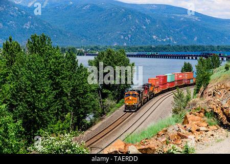 BNSF train along Lake Pend Oreille near Sandpoint, Idaho, USA - Stock Image