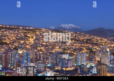 Blue hour, with Illimani towering over the density of La Paz, Bolivia - Stock Image