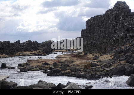 Large rocks and stream flowing between - Stock Image