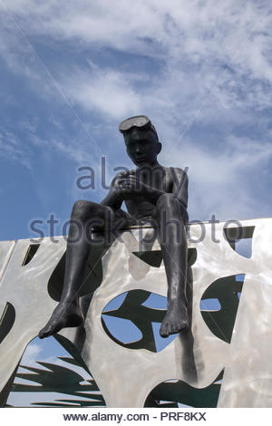 Young Charles sculpture at entrance to the Coralarium in Maldives - Stock Image