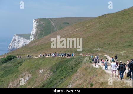 Lulworth, Dorset, UK. 23rd June 2018. Crowds of tourists visit the coast and beach at Durdle Door on the Dorset coast, near Lulworth Cove on a hot sunny day in June. Thomas Faull/Alamy Live News - Stock Image