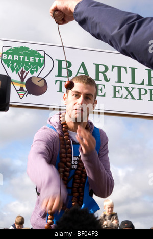 Joel Defries BBC Blue Peter TV presenter competing at the 45th World Conker Championships near Ashton Northamptonshire - Stock Image