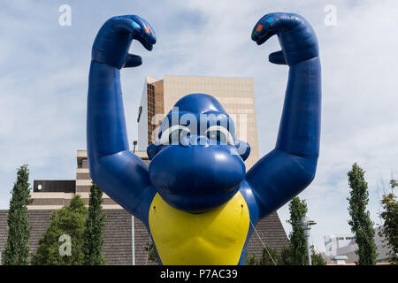 Anchorage, Alaska. 4th July, 2018. A giant inflatable gorilla float rises above the downtown during the annual Independence Day parade July 4, 2018 in Anchorage, Alaska. Credit: Planetpix/Alamy Live News - Stock Image
