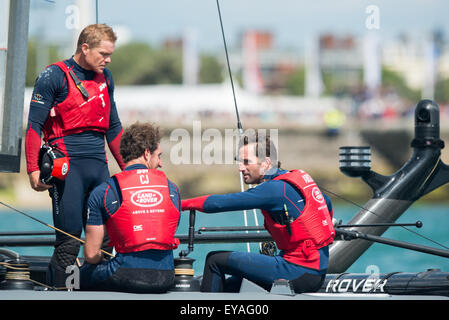 Portsmouth, UK. 25th July 2015. Ben Ainslie congratulates the team after second place in the second race of the - Stock Image