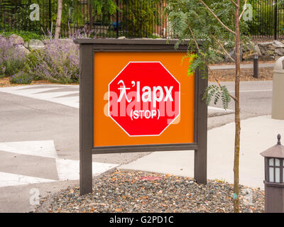 Dual language 'STOP' sign at Nk'mip Resort near Osoyoos, BC, Canada.   Sign is in Nsyilxcen language - Stock Image