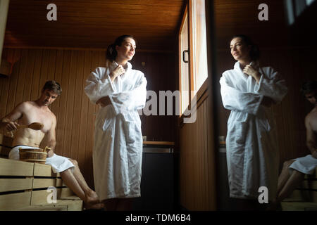 People pursuing healthy lifestyles relaxing in sauna - Stock Image
