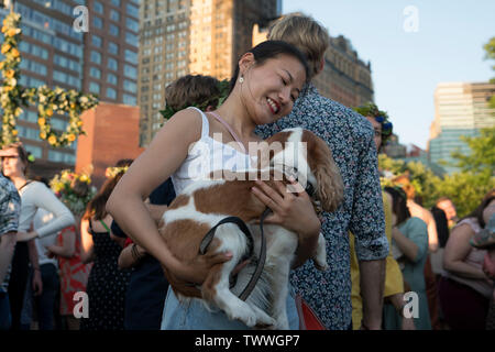 A woman brought her dog to the Swedish Midsummer Festival which takes place every year in Battery Park City's Wagner Park. June 21, 2019 - Stock Image