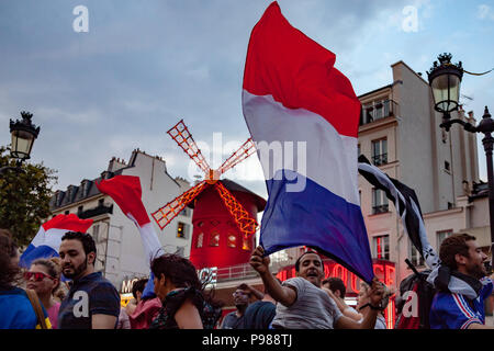 Paris, France. 15th July 2018. 2018, July 15th - Paris, France: Street of Paris crowded of happy soccer supporters after the final match France Croatia. Credit: Guillaume Louyot/Alamy Live News - Stock Image