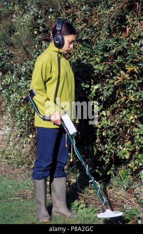 young girl out with metal detector - Stock Image