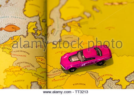 Mattel Hot Wheels violet toy Muscle Speeder car on a European map from a open educational book on circa June 2019 in Poznan, Poland. - Stock Image
