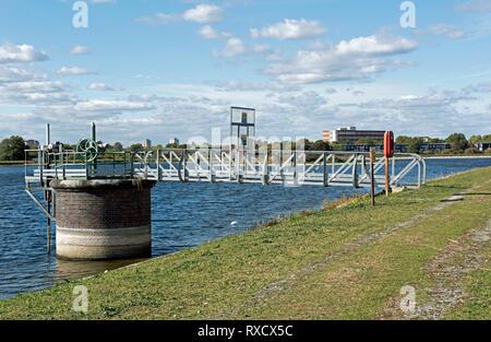 Water valve with bridge over reservoir, Walthamstow Wetlands. - Stock Image