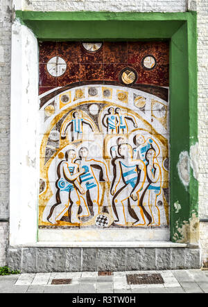 A retro-style 60s or 70s-looking tile wall panel on the side of a building in Aulla, Tuscany, Italy. - Stock Image