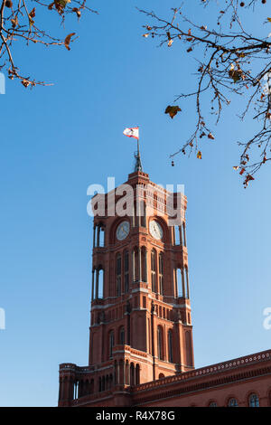 The Rotes Rathaus, or new city hall, in Berlin Germany. Framed by almost bare branches on a sunny winter day. - Stock Image