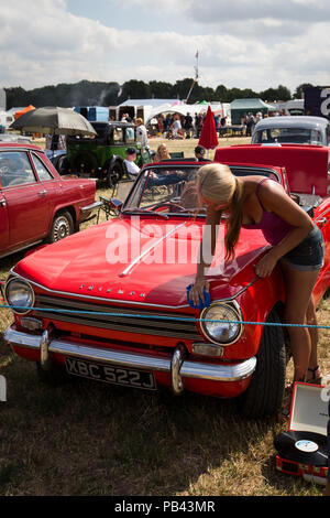 An immaculate Triumph Herald taking part in the classic car display at the 2018 Cheshire Steam Fair - Stock Image