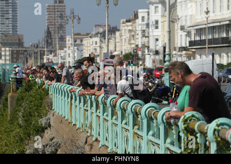 Brighton, UK - September 1 2018: People seen watching the National Speed Trials that run along Madeira Drive in Brighton​ on 1​ September 2018.   The Pier, in the central waterfront section, opened in 1899 houses amusement rides as well as food kiosks.Credit: David Mbiyu /Alamy Live News - Stock Image