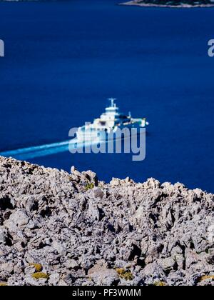 Ferry-boat Prizna-Zignjen island Pag to Croatia mainland blurry in background - Stock Image