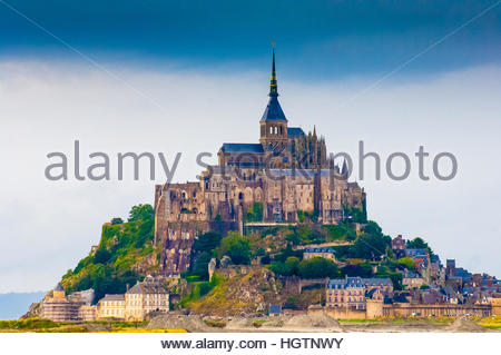 Mont St Michel on a cloudy & wet day in Normandy, France. The Benedictine Monks set up a commune here in 966. - Stock Image