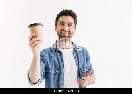 Portrait of a handsome bearded man wearing casual clothes standing isolated over white background, drinking takeaway coffee - Stock Image