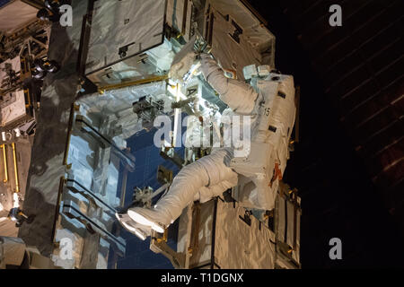 Expedition 59 NASA astronaut Nick Hague works on the power supply during a spacewalk outside the International Space Station March 22, 2019 in Earth Orbit. Astronauts McClain and Hague spent six-hours and 39-minutes outside the space station to upgrade the orbital complex's power storage capacity. - Stock Image