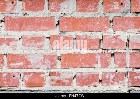 Messy cement in a brick wall - Stock Image