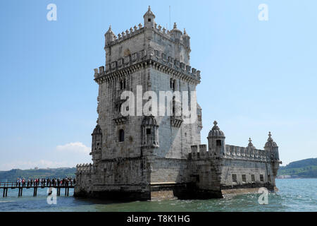 Tourists at Belem Tower landmark building queue on wooden bridge to visit inside UNESCO World Heritage Site in Lisbon Portugal Europe KATHY DEWITT - Stock Image